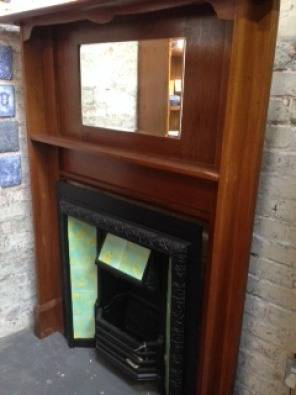 teak fireplace surround with bevelled mirror