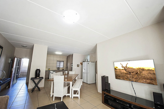 3 Bedroom upstairs unit no Garden but a patio with braai in Security Complex in Equestria.