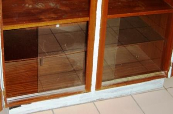 Two Door Wardrobe With Glass Fronted Packing Area At The
