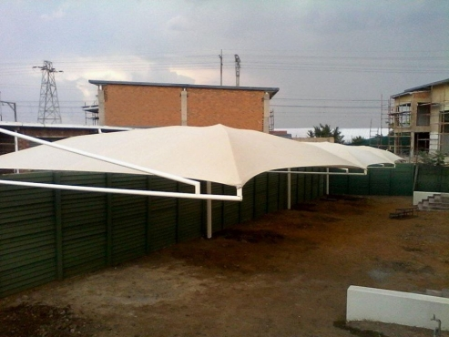 Shadeports carports installation zozo huts storage rooms Carport with storage room