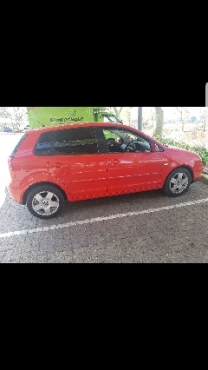 Red vw polo 2005 model for sale