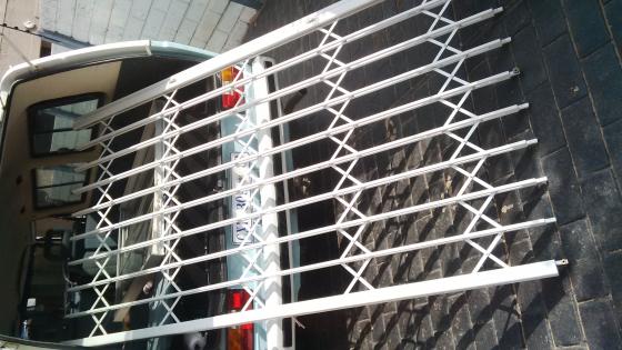 Expandable security gate centurion building materials