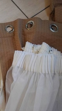 Custom made eyelet curtains with lining.