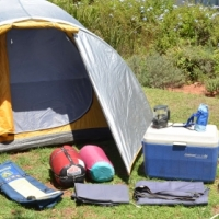 Bushbaby 4-man dome tent with additional camping equipment