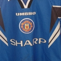 """Here is a Rare opportunity to purchase The King """"ERIC CANTONA"""" signed Umbro shirt."""