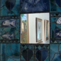 Mirror, mosaic, Blue with cat, fish and heart. Hand made and unique R200. Price not negotiable.