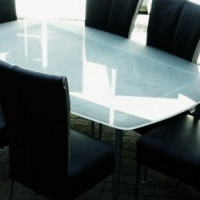 Glass table top and 6 high back black leather chairs