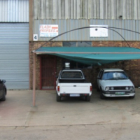 Factory with large covered carport