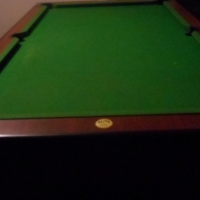 Elite coin operated pool table.
