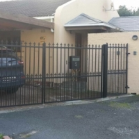 2 X BLACK METAL DRIVE WAY GATES WITH PEDESTRIAN GATE AND MAIL BOX