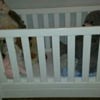 Pure white sleigh cot for sale.