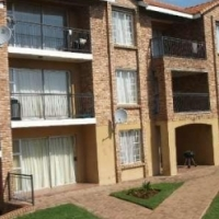 Neat top floor unit in a very secure complex to rent in Centurion