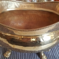 Brass oval pot with lion's feet