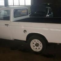 1975 Datsun 1500 met Ford 2.5 V6 enjin in