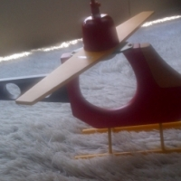 Brightly coloured wooden helicopter ceiling light fitting