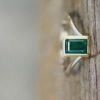 Emerald gold and platinum designer ring