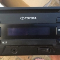 Toyota Car stereo with mounting brackets.