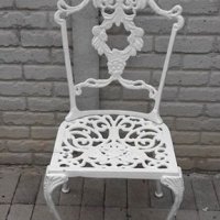 Single cast iron chair for sale.