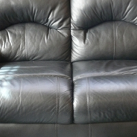Black leatherette couch.