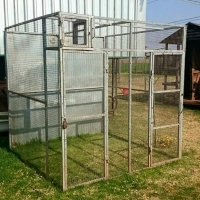 Galvanised cage with roof.