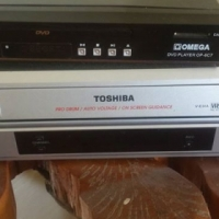 Toshiba VHS video machine with remote and 21 videos included