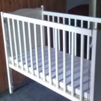 White cot for sale.