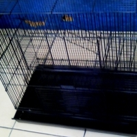 black pet cage it has a 2 level deck