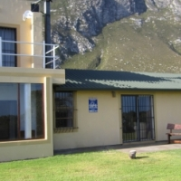 Beautiful four bedroom house with stunning views on mountain, vlei and sea