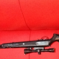Excellent air gun for sale with telescope and gun bag  value colse to 5000.00