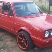 2X Volkswagens for sale with orange rims