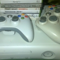 Xbox 360 2 remotes and 10 games whatsapp 0631312558