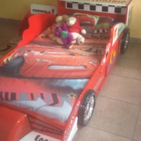 F1 racing car bed for kids in very good condition with side stand for sale