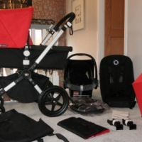 Red and Black Bugaboo Cameleon 3 Pram Plus MAxi Cosi Car Seat.