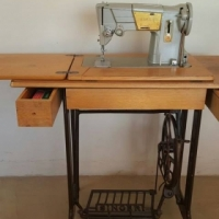 Sewing machine in a cupboard for sale