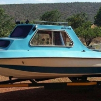 2 Boats: Cabin cruiser with 65 Suzuki with accessories, Vintage boat as is with 40 Evinrude