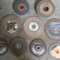 Assortment off 13 angle grinder cutting disks and bench grinder wheels