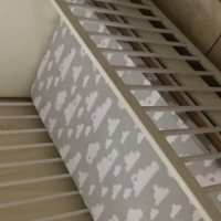 White baby cot with bottom drawer