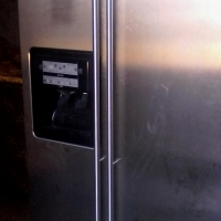 water and ice dispenser silver fridge