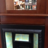 teak fireplace mantel and cast iron arts and crafts fireplace surround