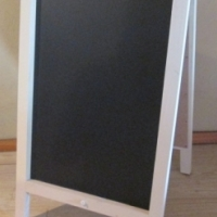 Chalkboards: A-frame, double sided. Wooden frame.