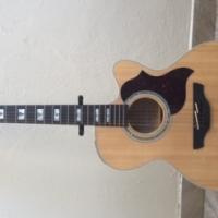 Takamine Jumbo Cutaway 12-String Acoustic-Electric Guitar – Natural blond.