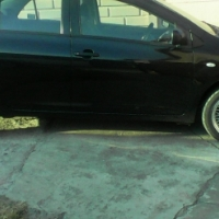 Toyota yaris.... Sedan 1.3  2007 model....black....109 km