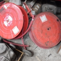 Water hoses on reels for fire extinguishing at Auctioneer Discount Price