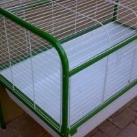 Large pet cage, excellent condition.