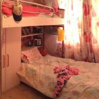 Two 3/4 beds with cupboard,book shelf storage and drawers.