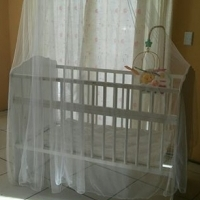 Adjustable wooden cot with accessories