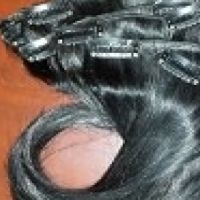 8pc clip in human hair extensions.