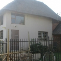 3.4HA plot with 2bed House flat and incomplete House 17km West of Pretoria