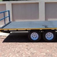 O.7. BRAND NEW FLAT DECK TRAILER 2700kg