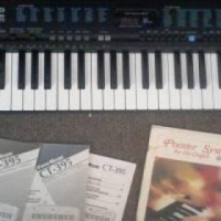 Casio Keyboard with instruction books.
